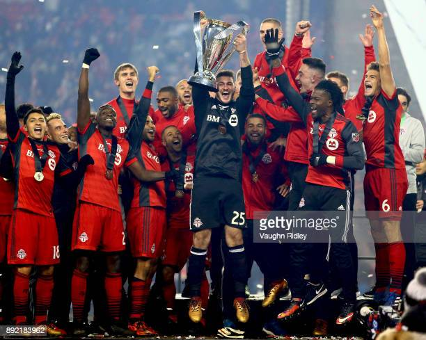 Alex Bono of Toronto FC lifts the Championship Trophy after winning the 2017 MLS Cup Final against the Seattle Sounders at BMO Field on December 9...