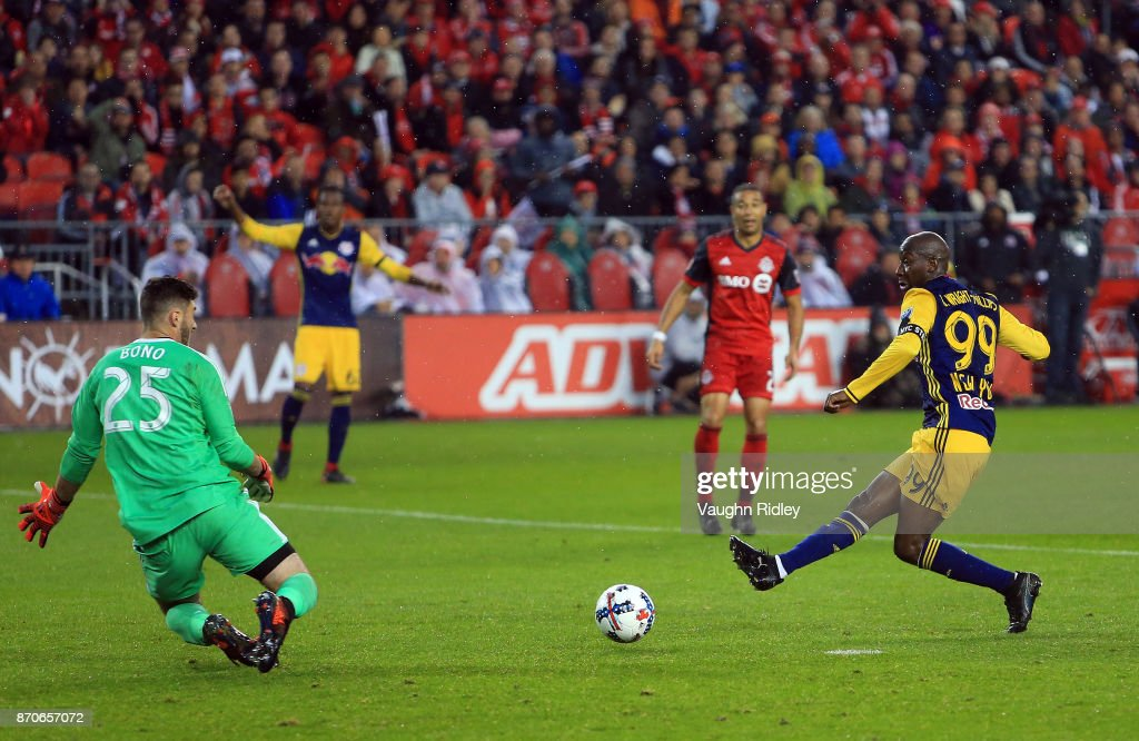 Alex Bono #25 of Toronto FC makes a save on a shot by Bradley Wright-Phillips #99 of New York Red Bulls during the second half of the MLS Eastern Conference Semifinal, Leg 2 game at BMO Field on November 5, 2017 in Toronto, Ontario, Canada.