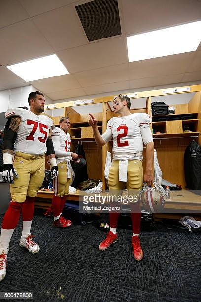 Alex Boone and Blaine Gabbert of the San Francisco 49ers talk in the locker room during halftime of the game against the Chicago Bears at Soldier...