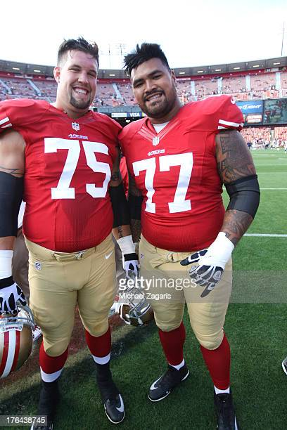 Alex Boone and Mike Iupati of the San Francisco 49ers stand on the field prior to the game against the Denver Broncos at Candlestick Park on August 8...