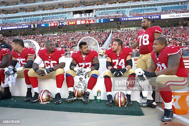 Alex Boone Marcus Martin Mike Iupati Joe Staley Joe Looney and Jonathan Martin of the San Francisco 49ers relax on the sideline during the game...