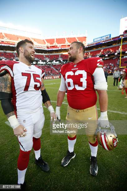 Alex Boone of the Arizona Cardinals abd Brandon Fusco of the San Francisco 49ers talk on the field following the game at Levi's Stadium on November 5...