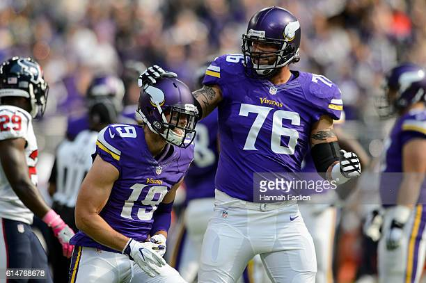 Alex Boone of the Minnesota Vikings congratulates teammate Adam Thielen on scoring a touchdown against the Houston Texans during the game on October...