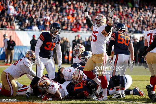 Alex Boone of the San Francisco 49ers celebrates after Shaun Draughn scored a touchdown against the Chicago Bears in the second quarter at Soldier...