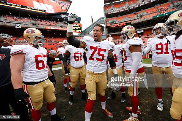 Alex Boone of the San Francisco 49ers fires the team up on the field prior to the game against the Cleveland Browns at Browns Stadium on December 13...
