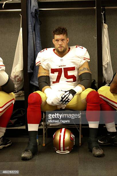 Alex Boone of the San Francisco 49ers relaxes in the locker room prior to the game against the Oakland Raiders at Oco Coliseum on December 7 2014 in...