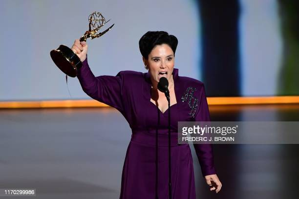 """Alex Borstein accepts the Supporting Actress, Comedy award for """"The Marvelous Mrs. Maisel"""" onstage during the 71st Emmy Awards at the Microsoft..."""