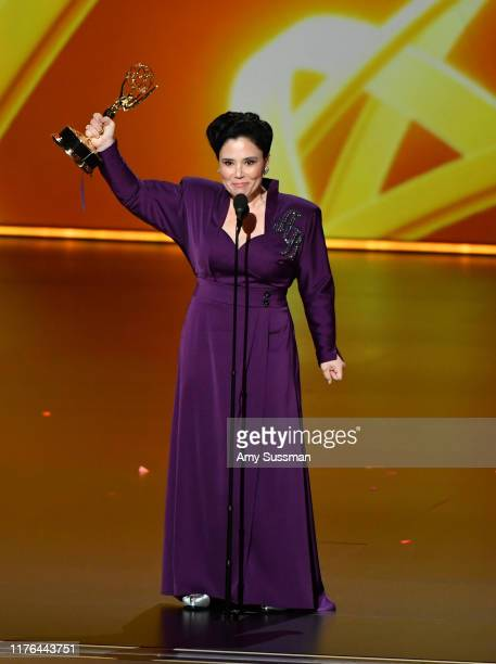 """Alex Borstein accepts the Supporting Actress, Comedy award for """"The Marvelous Mrs. Maisel"""" onstage during the 71st Emmy Awards at Microsoft Theater..."""