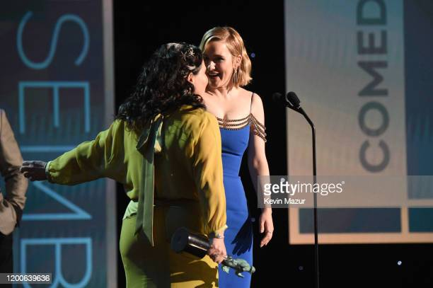 Alex Borstein and Rachel Brosnahan accept the Outstanding Performance by an Ensemble in a Comedy Series award for 'The Marvelous Mrs Maisel' onstage...