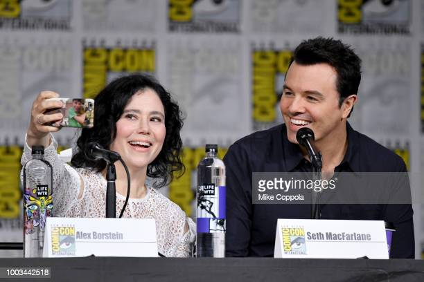Alex Borstein and Seth MacFarlane take a selfie onstage at the 'American Dad' and 'Family Guy' Panel during ComicCon International 2018 at San Diego...