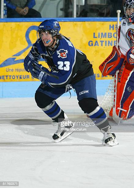 Alex Bourret of the Lewiston MAINEiacs skates against the Gatineau Olympiques on October 11, 2004 at Centre Robert-Guertin in Gatineau, Quebec,...