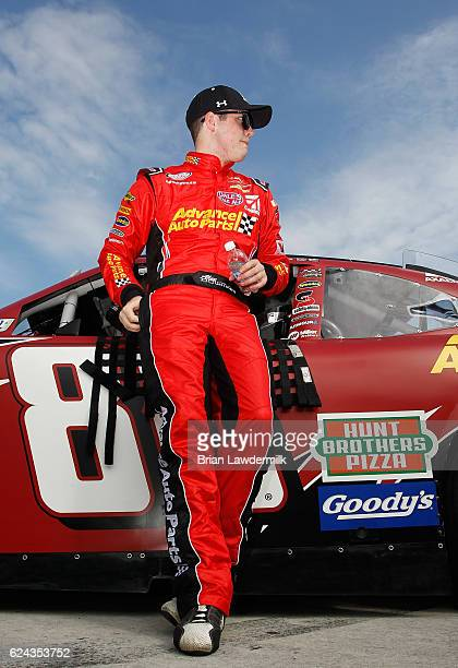 Alex Bowman driver of the Advance Auto Parts Chevrolet stands on the grid during qualifying for the NASCAR XFINITY Series Ford EcoBoost 300 at...
