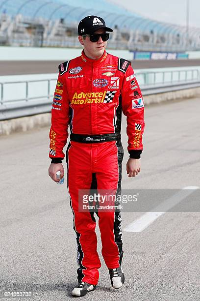 Alex Bowman driver of the Advance Auto Parts Chevrolet walks on the grid during qualifying for the NASCAR XFINITY Series Ford EcoBoost 300 at...