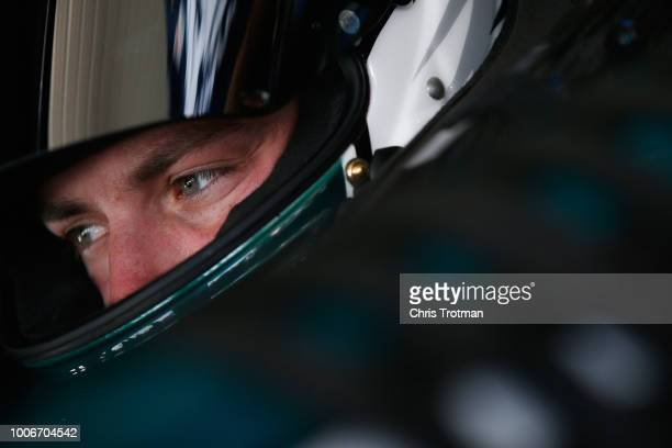 Alex Bowman driver of the AXALTA AllPro Teachers Chevrolet sits in his car during practice for the Monster Energy NASCAR Cup Series Gander Outdoors...