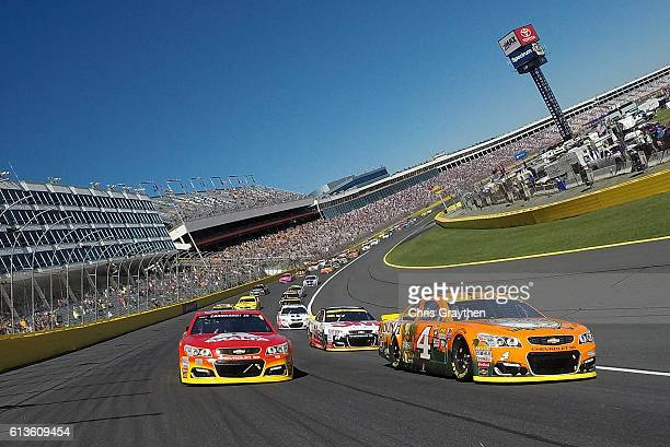 Alex Bowman driver of the Axalta Chevrolet and Kevin Harvick driver of the Busch Hunting Chevrolet lead the field at the start of the NASCAR Sprint...