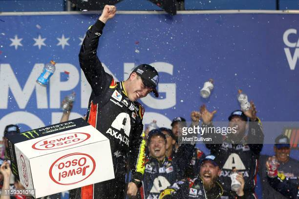 Alex Bowman driver of the Axalta Chevrolet celebrates in Victory Lane after winning the Monster Energy NASCAR Cup Series Camping World 400 at...
