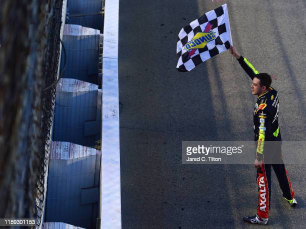 Alex Bowman driver of the Axalta Chevrolet celebrates with the checkered flag after winning the Monster Energy NASCAR Cup Series Camping World 400 at...