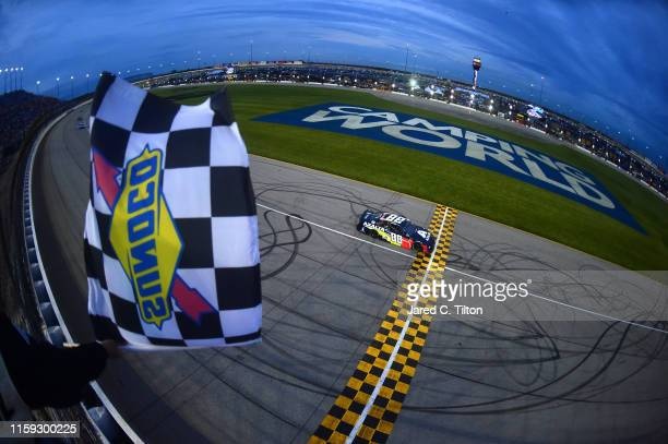 Alex Bowman driver of the Axalta Chevrolet crosses the finish line to win the Monster Energy NASCAR Cup Series Camping World 400 at Chicagoland...