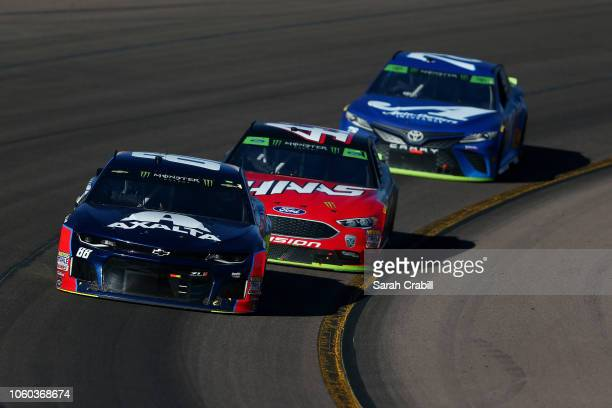 Alex Bowman driver of the Axalta Chevrolet leads a group of cars during the Monster Energy NASCAR Cup Series CanAm 500 at ISM Raceway on November 11...