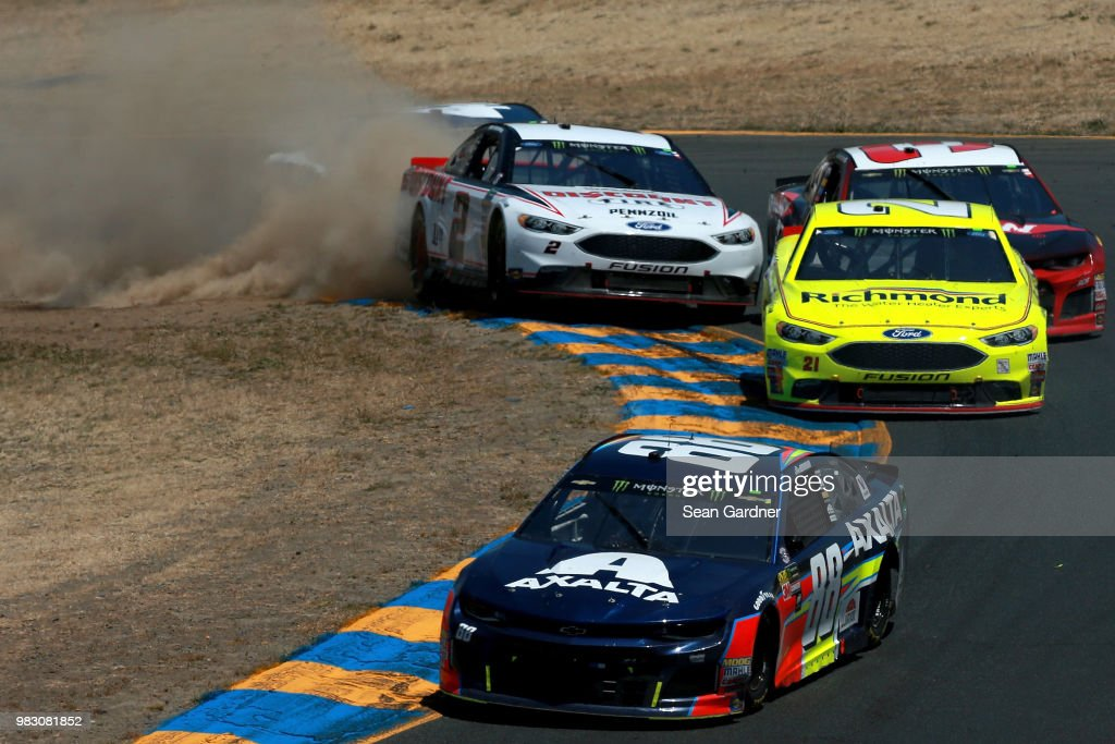 Alex Bowman, driver of the #88 Axalta Chevrolet, leads a pack of cars as Brad Keselowski, driver of the #2 Discount Tire Ford, drives off track during the Monster Energy NASCAR Cup Series Toyota/Save Mart 350 at Sonoma Raceway on June 24, 2018 in Sonoma, California.