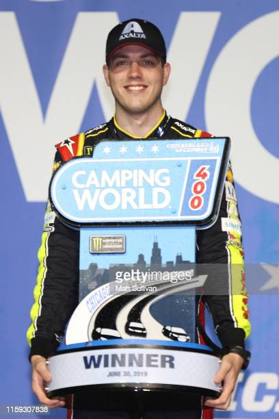 Alex Bowman driver of the Axalta Chevrolet poses with the trophy after winning the Monster Energy NASCAR Cup Series Camping World 400 at Chicagoland...