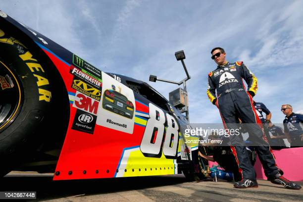 Alex Bowman driver of the Axalta Chevrolet prepares to drive during qualifying for the Monster Energy NASCAR Cup Series Bank of America Roval 400 at...
