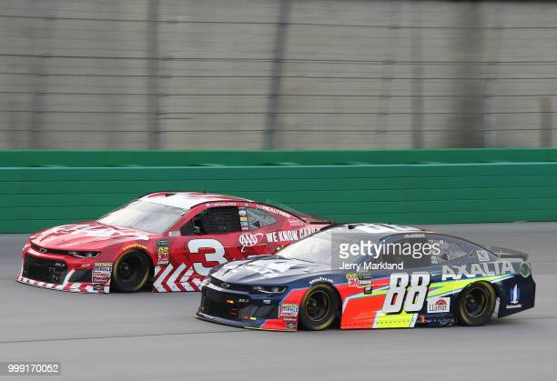 Alex Bowman driver of the Axalta Chevrolet races Austin Dillon driver of the AAA Chevrolet during the Monster Energy NASCAR Cup Series Quaker State...