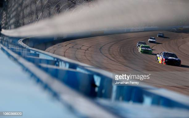 Alex Bowman driver of the Axalta Chevrolet races during the Monster Energy NASCAR Cup Series CanAm 500 at ISM Raceway on November 11 2018 in Phoenix...