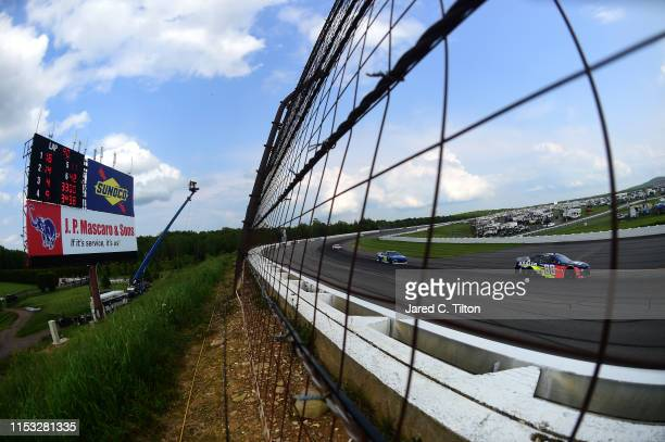 Alex Bowman driver of the Axalta Chevrolet races during the Monster Energy NASCAR Cup Series Pocono 400 at Pocono Raceway on June 02 2019 in Long...