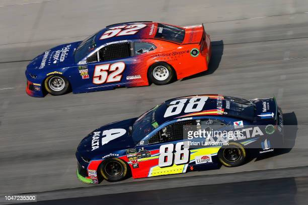 Alex Bowman, driver of the Axalta Chevrolet, races Harrison Rhodes, driver of the The Medicine Shoppe Chevrolet, during the Monster Energy NASCAR Cup...