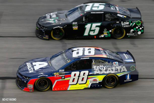 Alex Bowman driver of the Axalta Chevrolet races Ross Chastain driver of the LowT Center Chevrolet during the Monster Energy NASCAR Cup Series Folds...
