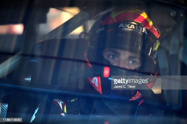 Alex Bowman, driver of the Axalta Chevrolet, sits in his car during practice for the Monster Energy NASCAR Cup Series Bluegreen Vacations 500 at ISM...