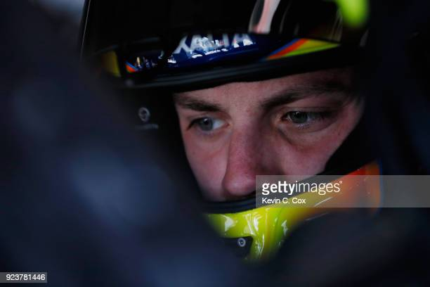 Alex Bowman driver of the Axalta Chevrolet sits in his car during practice for the Monster Energy NASCAR Cup Series Folds of Honor QuikTrip 500 at...
