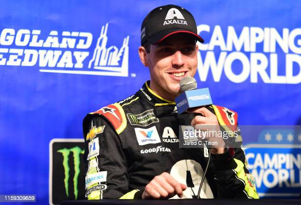 Alex Bowman driver of the Axalta Chevrolet speaks with the media after winning the Monster Energy NASCAR Cup Series Camping World 400 at Chicagoland...