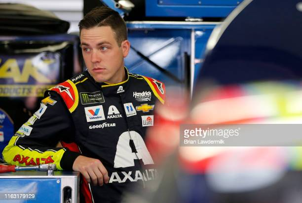 Alex Bowman driver of the Axalta Chevrolet stands in the garage area during practice for the Monster Energy NASCAR Cup Series Foxwoods Resort Casino...