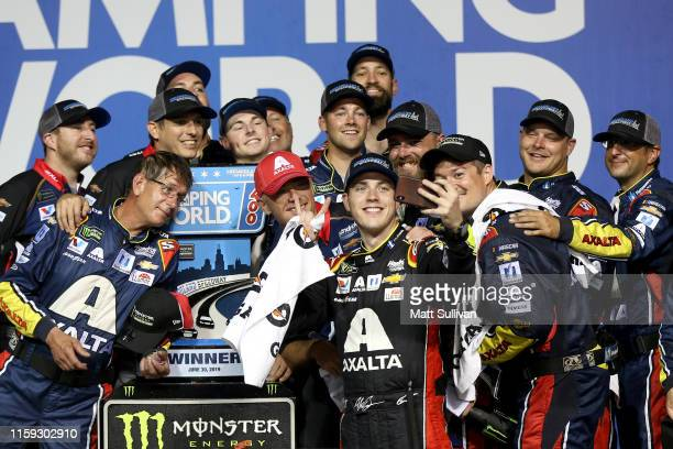 Alex Bowman driver of the Axalta Chevrolet takes a selfie with his team in Victory Lane after winning the Monster Energy NASCAR Cup Series Camping...