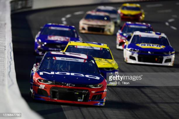 Alex Bowman, driver of the ChevyGood.com/NOCO Patriotic Chevrolet, leads a pack of cars during the NASCAR Cup Series Coca-Cola 600 at Charlotte Motor...
