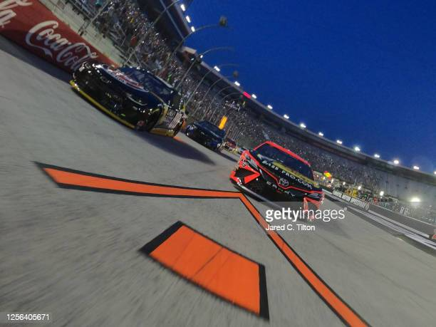 Alex Bowman driver of the ChevyGoodscom/Adam's Polishes Chevrolet and Martin Truex Jr driver of the Bass Pro Shops Toyota lead the field on a pace...