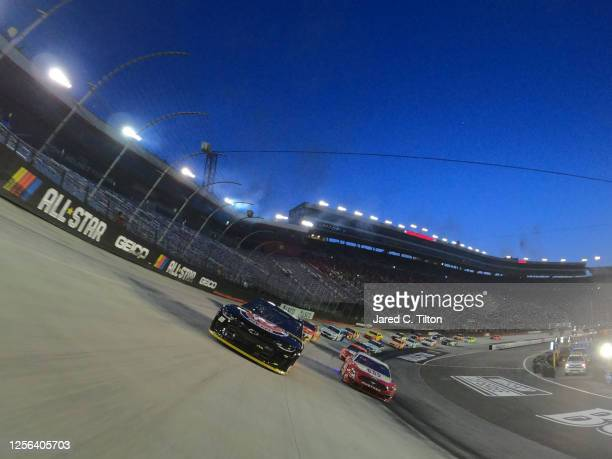Alex Bowman driver of the ChevyGoodscom/Adam's Polishes Chevrolet and Ryan Blaney driver of the BodyArmor Ford lead the field on a pace lap prior to...