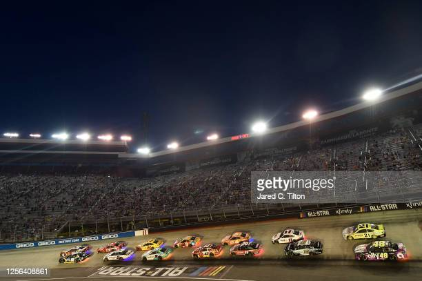 Alex Bowman driver of the ChevyGoodscom/Adam's Polishes Chevrolet and Ryan Blaney driver of the BodyArmor Ford lead the field during the NASCAR Cup...