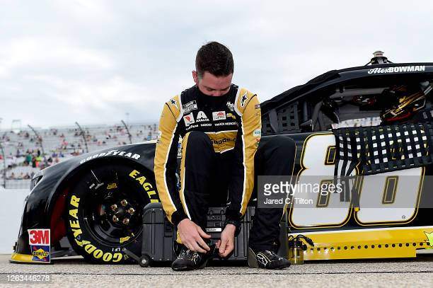 Alex Bowman driver of the ChevyGoodscom/Adam's Polishes Chevrolet prepares for the NASCAR Cup Series Foxwoods Resort Casino 301 at New Hampshire...