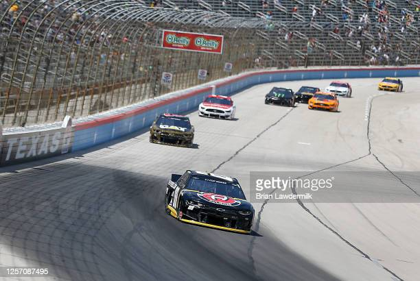 Alex Bowman driver of the ChevyGoodscom/Adam's Polishes Chevrolet leads a pack of cars during the NASCAR Cup Series O'Reilly Auto Parts 500 at Texas...