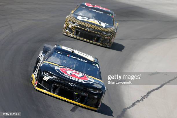 Alex Bowman driver of the ChevyGoodscom/Adam's Polishes Chevrolet leads Tyler Reddick driver of the Cat Oil Gas Chevrolet during the NASCAR Cup...