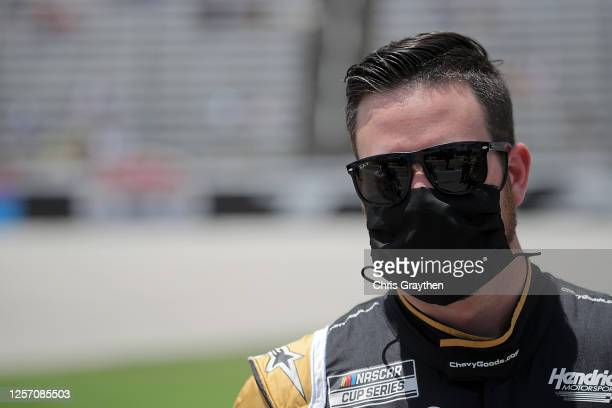 Alex Bowman driver of the ChevyGoodscom/Adam's Polishes Chevrolet stands on the grid prior to the NASCAR Cup Series O'Reilly Auto Parts 500 at Texas...
