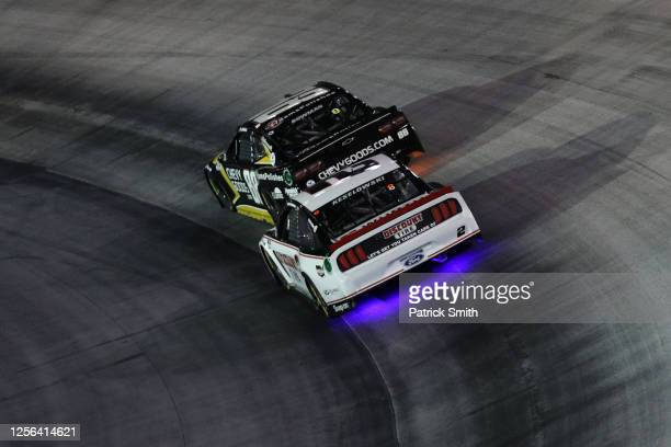 Alex Bowman driver of the ChevyGoodscom/Adam's Polishes Chevrolet races Brad Keselowski driver of the Discount Tire Ford during the NASCAR Cup Series...