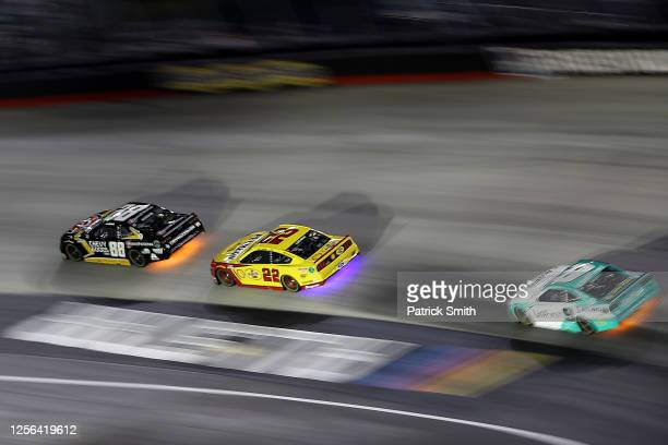 Alex Bowman driver of the ChevyGoodscom/Adam's Polishes Chevrolet races Joey Logano driver of the Shell Pennzoil Ford and Chase Elliott driver of the...