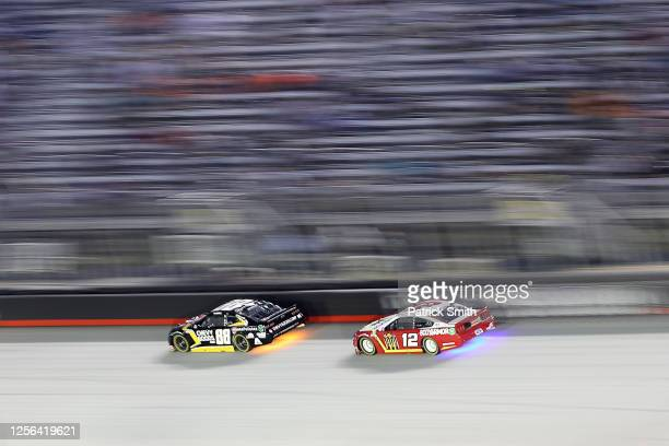 Alex Bowman driver of the ChevyGoodscom/Adam's Polishes Chevrolet races Ryan Blaney driver of the BodyArmor Ford during the NASCAR Cup Series AllStar...