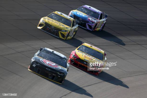 Alex Bowman driver of the ChevyGoodscom/Adam's Polishes Chevrolet races Joey Logano driver of the Shell Pennzoil Ford Erik Jones driver of the...