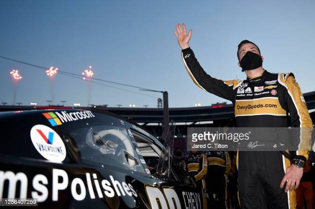 Alex Bowman driver of the ChevyGoodscom/Adam's Polishes Chevrolet waves to the fans prior to the NASCAR Cup Series AllStar Race at Bristol Motor...