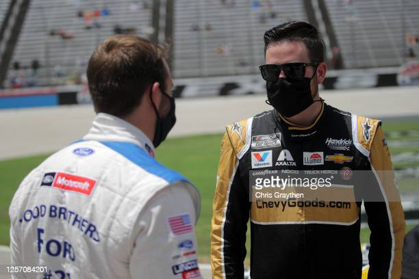 Alex Bowman driver of the ChevyGoodscom/Adam's Polishes Chevrolet speaks with Matt DiBenedetto driver of the Motorcraft/Quick Lane Ford on the grid...